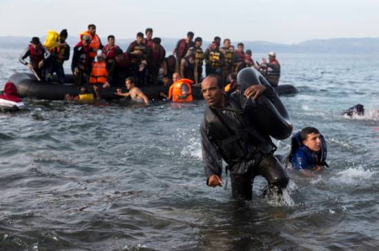 Migrants and refugees arrive on a dinghy after crossing from Turkey to Lesbos island, Greece, Wednesday, Sept. 9, 2015. The head of the European Union's executive says 22 of the member states should be forced to accept another 120,000 people in need of international protection who have come toward the continent at high risk through Greece, Italy and Hungary. (AP Photo/Petros Giannakouris)